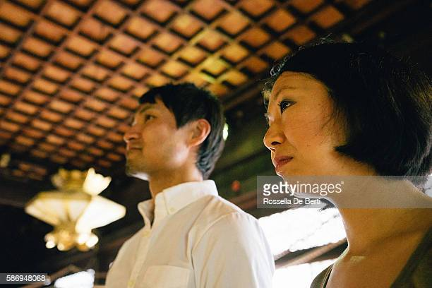 Japanese couple visiting a buddhist temple