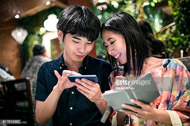 Japanese couple visiting tokyo looking at map