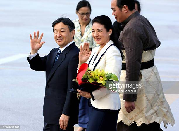 Japanese Crown Prince Naruhito and Crown Princess Masako wave to wellwishers upon arrival at Fua'amotu International Airport on July 3 2015 in...