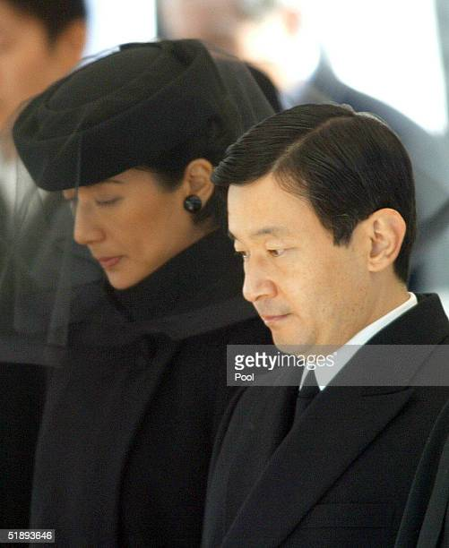 Japanese Crown Prince Naruhito and Princess Masako attend the funeral of the late Princess Kikuko at the Toshimagaoka cemetery December 26 2004 in...