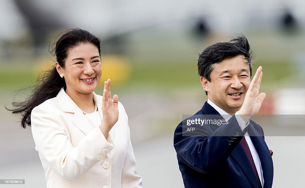 Japanese Crown Prince Naruhito (R) and Princess Masako wave before departing from Schiphol Airport, near Amsterdam, on May 2, 2013. The Japanese royals were invited to the Netherlands for the investiture of Prince Willem-Alexander as King on April 30, 2013. netherlands out