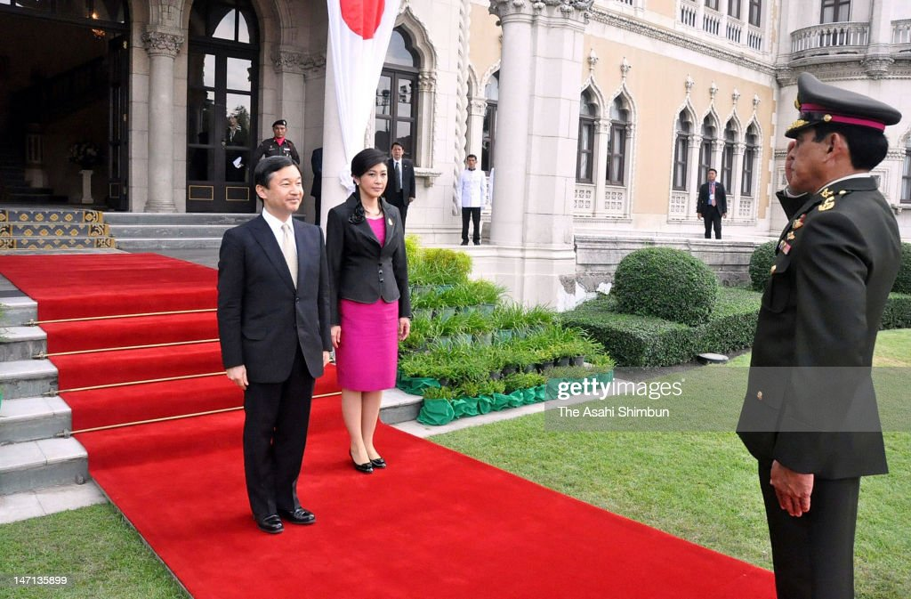 Japanese Crown Prince Naruhito (L) and Thai Prime Minister Yinglak Shinawatra attend the honor guard at the office of the Prime Minister on June 25, 2012 in Bangkok, Thailand. The Crown Prince Naruhito is on the 7-day visit to Thailand, Cambodia and Laos.