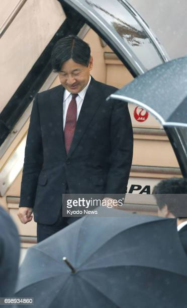 Japanese Crown Prince Naruhito arrives at Tokyo's Haneda airport on June 21 returning from a weeklong visit to Denmark to celebrate 150 years of...