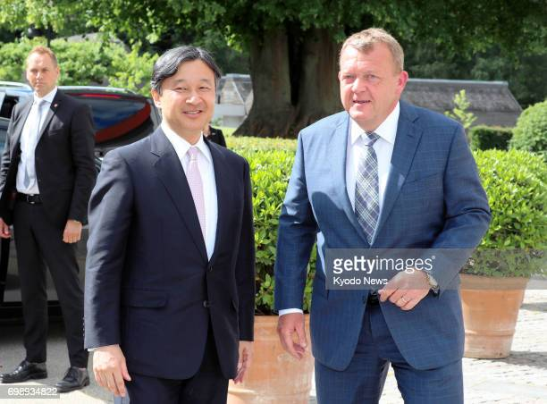 Japanese Crown Prince Naruhito is greeted by Danish Prime Minister Lars Lokke Rasmussen ahead of their talks in a city near Copenhagen on June 20 at...