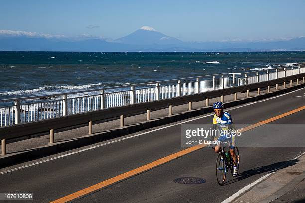 Japanese cyclist rides along the Shonan coast south of Tokyo The high cost of energy has always made bicycles a popular mode of transport in Japan...