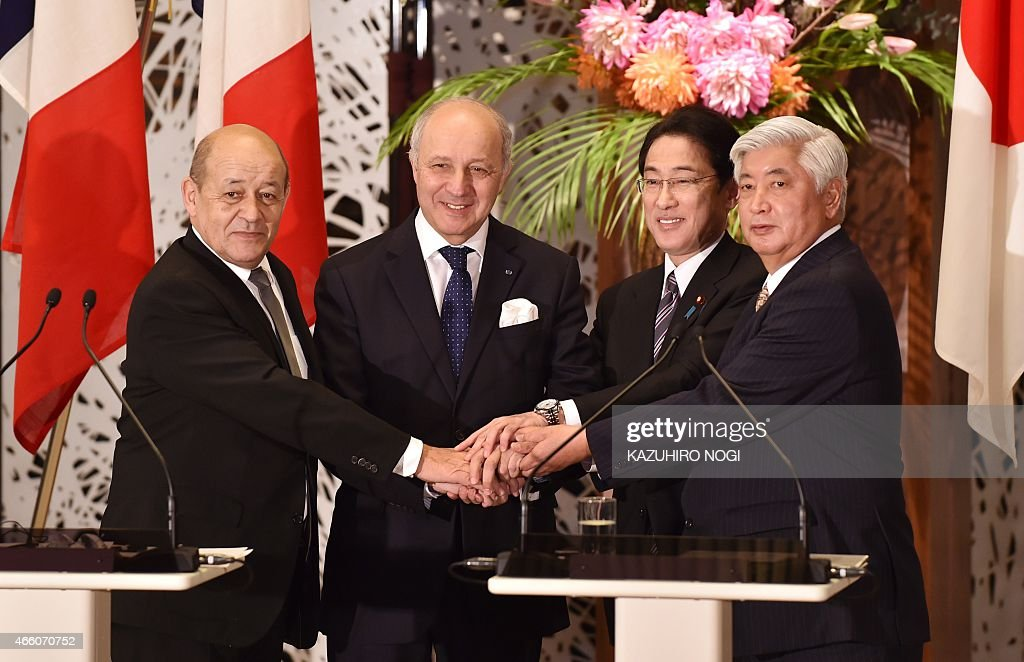 Japanese Defence Minister <a gi-track='captionPersonalityLinkClicked' href=/galleries/search?phrase=Gen+Nakatani&family=editorial&specificpeople=2676983 ng-click='$event.stopPropagation()'>Gen Nakatani</a> (R) and Foreign Minister <a gi-track='captionPersonalityLinkClicked' href=/galleries/search?phrase=Fumio+Kishida&family=editorial&specificpeople=10093794 ng-click='$event.stopPropagation()'>Fumio Kishida</a> (2nd R) and their French counterparts <a gi-track='captionPersonalityLinkClicked' href=/galleries/search?phrase=Jean-Yves+Le+Drian&family=editorial&specificpeople=2122785 ng-click='$event.stopPropagation()'>Jean-Yves Le Drian</a> (L) and <a gi-track='captionPersonalityLinkClicked' href=/galleries/search?phrase=Laurent+Fabius&family=editorial&specificpeople=540660 ng-click='$event.stopPropagation()'>Laurent Fabius</a> (2nd L) shake hands after their joint press conference at the Iikura guest house in Tokyo on March 13, 2015. France and Japan agreed to work together on researching military equipment, as Tokyo looks to broaden its defence ties and bolster its international profile.