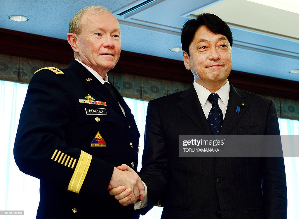 Japanese Defence Minister Itsunori Onodera (R) welcomes General Martin Dempsey (L), chairman of the US Joint Chiefs of Staff, during their talks at the Defence Ministry in Tokyo on April 26, 2013. The US's top military officer said in Japan on April 25 that his troops were ready to act if North Korea turned its increasingly bellicose rhetoric into action. AFP PHOTO / Toru YAMANAKA
