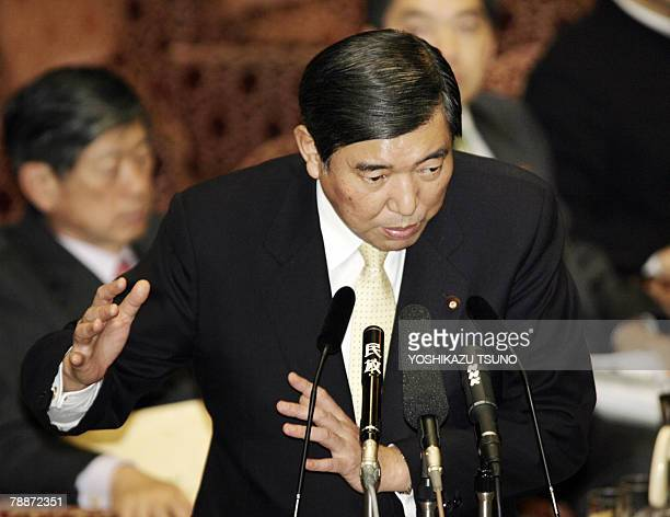 Japanese Defence Minister Shigeru Ishiba answers a question during the Upper House's committee session to resume a disputed mission backing the USled...