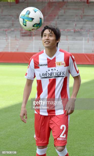 Japanese defender Atsuto Uchida poses for photos in Berlin on Aug 23 wearing the uniform of German secondtier side Union Berlin after transferring...