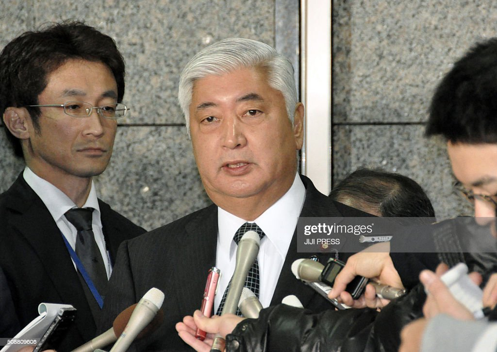 Japanese Defense Minister Gen Nakatani is surrounded by reporters at his office in Tokyo on February 7, 2016 as North Korea launched a rocket. North Korea launched a long-range rocket on February 7, violating UN resolutions and doubling down against an international community already determined to punish Pyongyang for a nuclear test last month. AFP PHOTO / JIJI PRESS JAPAN OUT / AFP / JIJI PRESS / JIJI PRESS