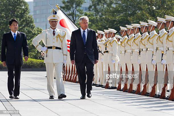 Japanese Defense Minister Itsunori Onodera and US Secretary of Defense Chuck Hagel review an honor guard at Defense Ministry on October 3 2013 in...