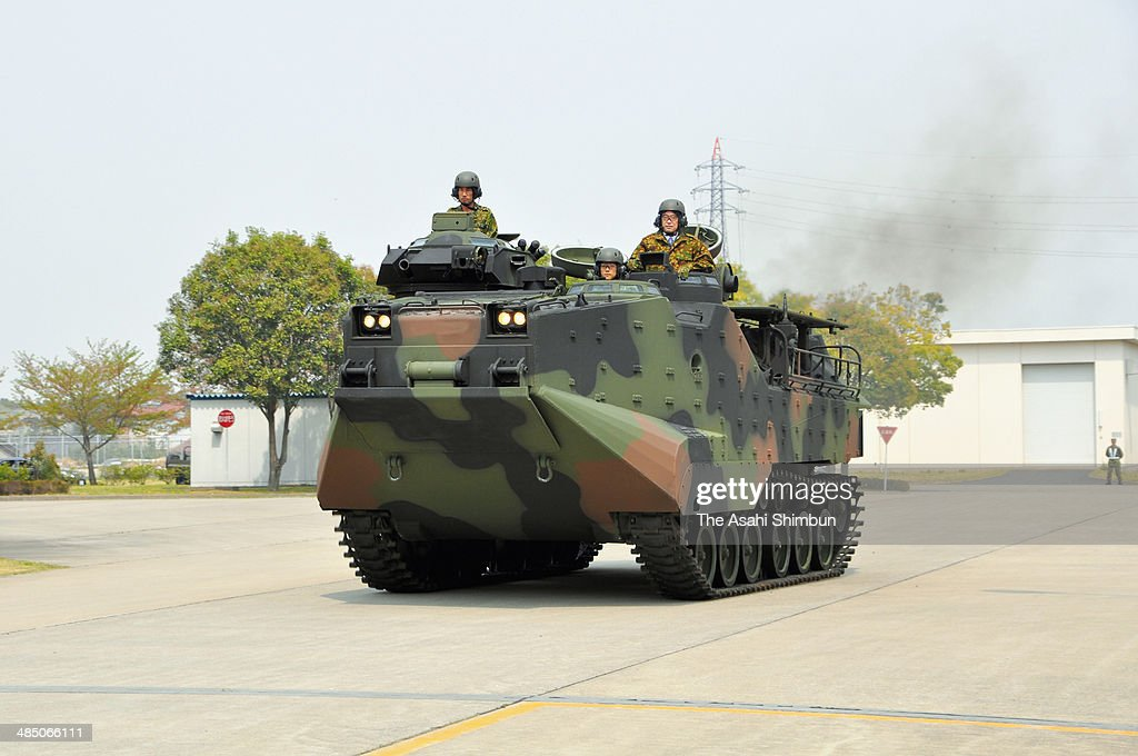 Japanese Defense Minister Itsunori Onodera (R) inspects the Ground Self-Defense Force (JGSDF) amphibious vehicle at the JGSDF Kasumigaura Base on April 16, 2014 in Tsuchiura, Ibaraki, Japan.