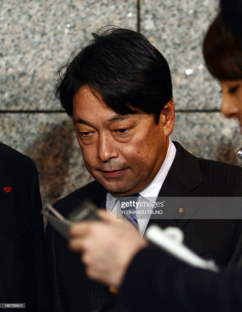 Japanese Defense Minister Itsunori Onodera listens to reporters at the Defense Ministry in Tokyo on February 5, 2013. A Chinese military frigate locked its weapon-targeting radar on a Japanese navy vessel on at least one occasion last month, in an apparent upping of the stakes in a bitter territorial row. AFP PHOTO / Yoshikazu TSUNO