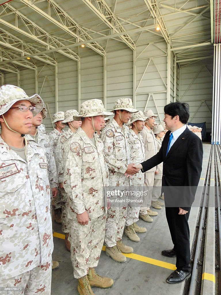 Japanese Defense Minister Itsunori Onodera shakes hands with members of the Self-Defense Force who deploy to cope with pirates at the Red Sea and Indian Ocean on May 9, 2014 in Djibouti.