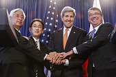 Japanese Defense Minister Nakatani Japanese Foreign Minister Kishida US Secretary of State John Kerry and Secretary of Defense Ashton Carter pose for...