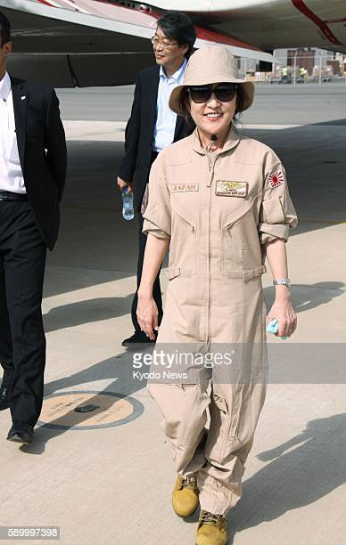 Japanese Defense Minister Tomomi Inada disembarks from a Maritime SelfDefense Force P3C patrol aircraft in Djibouti following her inspection of the...