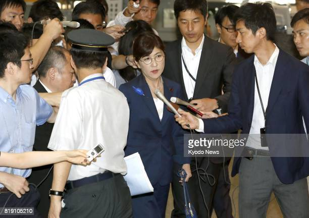 Japanese Defense Minister Tomomi Inada is surrounded by reporters upon her arrival at the ministry in Tokyo on July 20 2017 The government has denied...