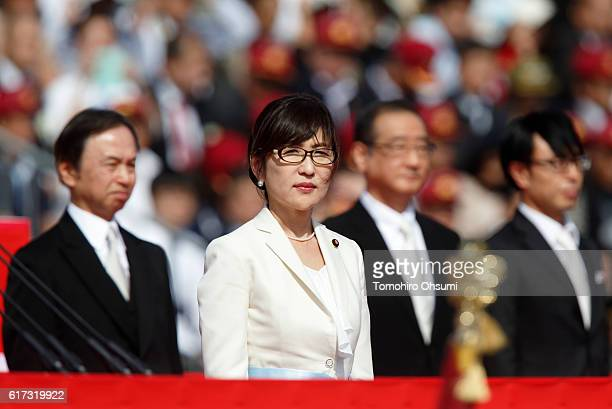 Japanese Defense Minister Tomomi Inada reviews troops of the Self Defense Forces marching during the annual review at the Japan Ground SelfDefense...
