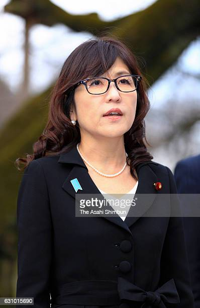 Japanese Defense Minister Tomomi Inada speaks to media reporters during her visit to Yasukuni Shrine on December 29 2016 in Tokyo Japan