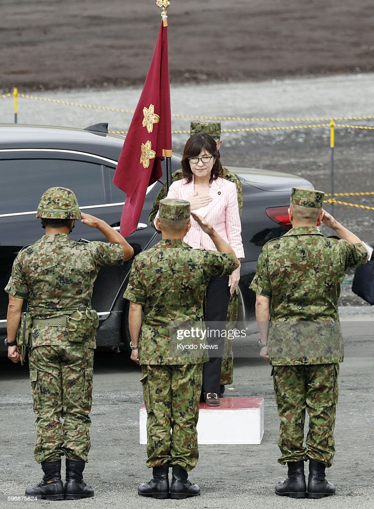Japanese Defense Minister Tomomi Inada visits the HigashiFuji training range at the foot of Mt Fuji in Gotemba Shizuoka Prefecture on Aug 28 to see...