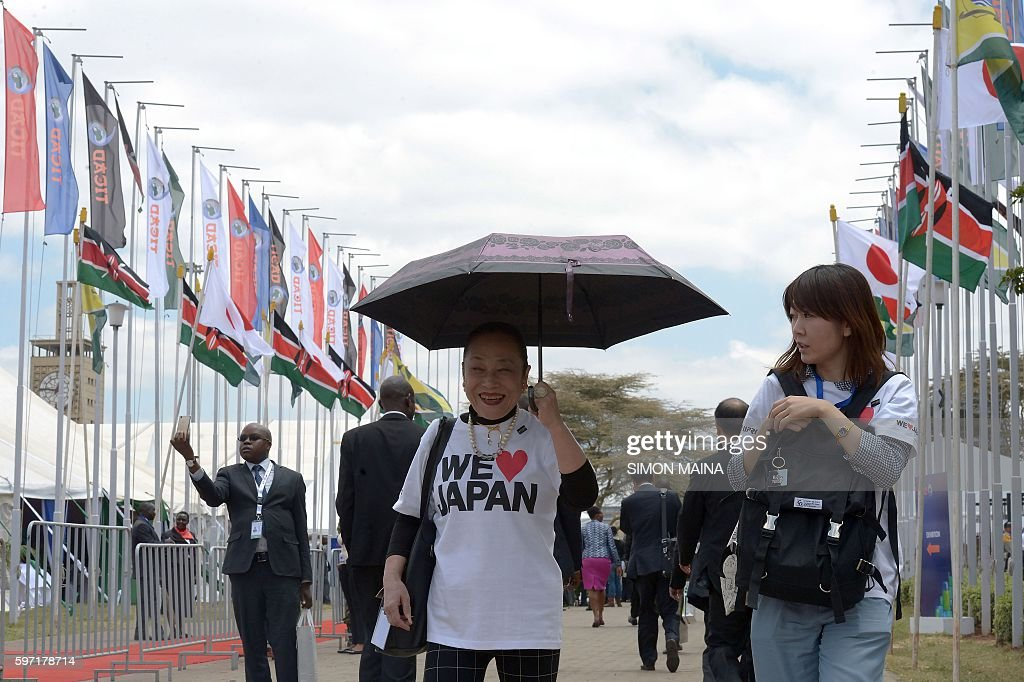 Japanese delegates arrive to attend the High level meeting during the Tokyo International Conference on African Development in Nairobi on August 28...