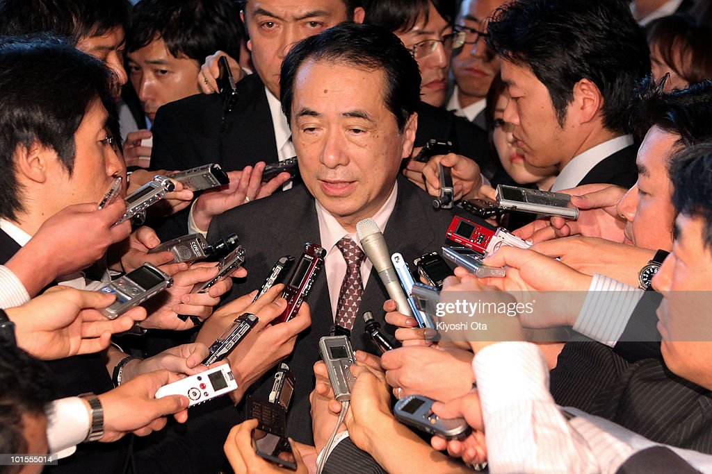 Japanese Deputy Prime Minister and Finance Minister Naoto Kan (C) speaks to the media at outgoing Prime Minister Yukio Hatoyama's official residence on June 2, 2010 in Tokyo, Japan. Hatoyama resigned after he failed to keep public support on the U.S. Marine Corp Futenma Airbase relocation issue. Kan announced his wish to run for Hatoyama's successor.