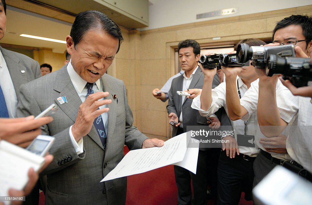 Japanese Deputy Prime Minister and Finance Minister <a gi-track='captionPersonalityLinkClicked' href=/galleries/search?phrase=Taro+Aso&family=editorial&specificpeople=559212 ng-click='$event.stopPropagation()'>Taro Aso</a> reads a comment to retract his recent remarks at Finance Ministry on August 1, 2013 in Tokyo, Japan. Aso commented that Japan could learn from Nazi Germany on the constitution revision during a symposium.