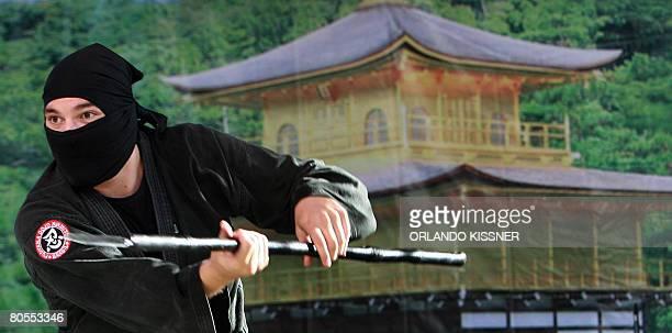 A Japanese descendant performs a Ninja fight during 'Hana Matsuri' celebrations on April 6 in Curitiba Brazil in the framework of the 100 anniversary...