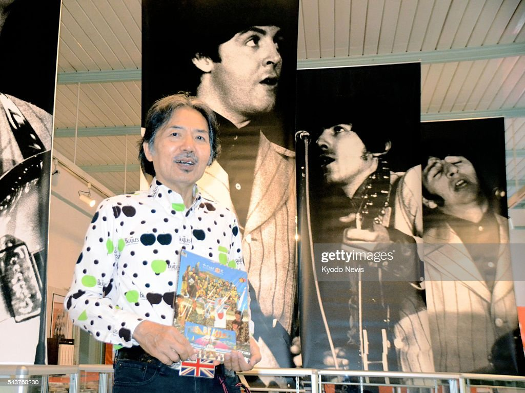 Japanese designer Sonau Okamoto, a major collector of Beatles memorabilia, poses for a photo as a Beatles' exhibition opens at Ako Folk Culture Museum in Ako, Hyogo Prefecture, on June 30, 2016, to mark the 50th anniversary of the legendary pop group's visit to Japan. About 1,000 items, including records and books, are on display through Aug. 30.