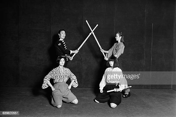 Japanese designer Yamamoto Kansai with three models practicing kendo