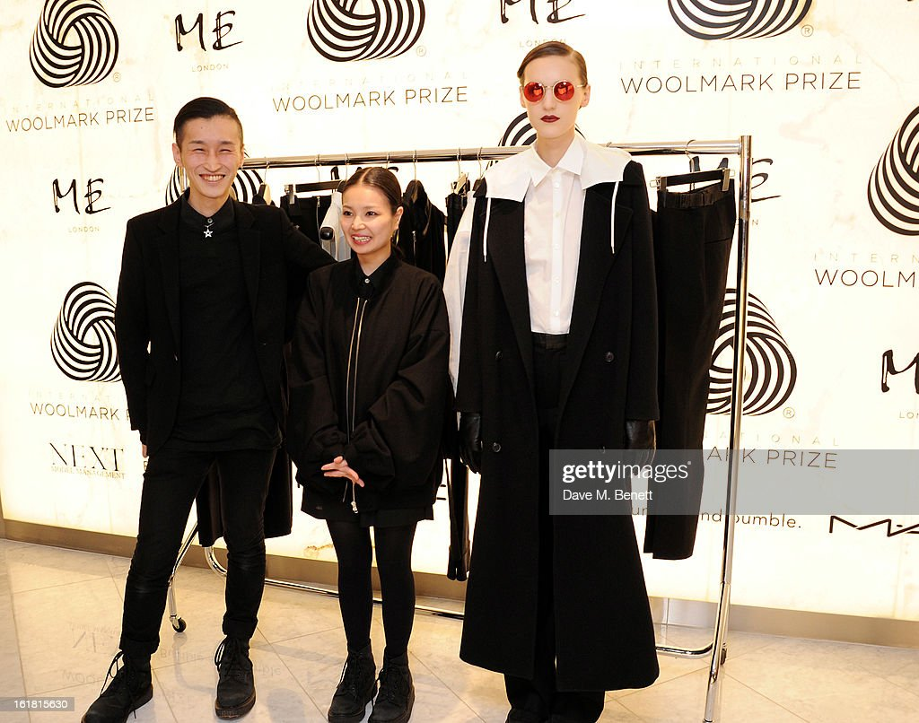 Japanese designers Takeshi Kitazawa and Emiko Sato of DRESSEDUNDRESSED pose with a model (R) wearing their design at the 2013 International Woolmark Prize Final at ME London on February 16, 2013 in London, England.