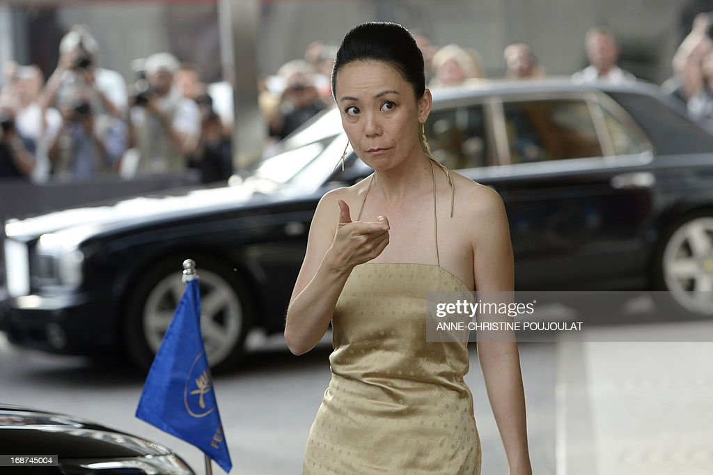 Japanese director and member of the Feature Film Jury, Naomi Kawase gestures on May 14, 2013 as she arrives at the Martinez Hotel in Cannes to attend a photocall of the Jury on the eve of the 66th edition of the Cannes Film Festival. Cannes, one of the world's top film festivals, opens on May 15 and will climax on May 26 with awards selected by a jury headed this year by Hollywood legend Steven Spielberg.