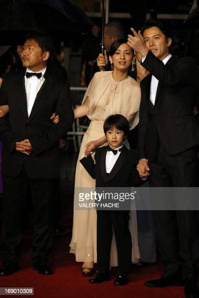 Japanese director Hirokazu Kore-Eda and actors Machiko Ono ...