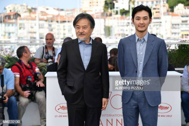 Japanese director Kiyoshi Kurosawa and Japanese actor Ryuhei Matsuda pose on May 21 2017 during a photocall for the film 'Before We Vanish ' at the...