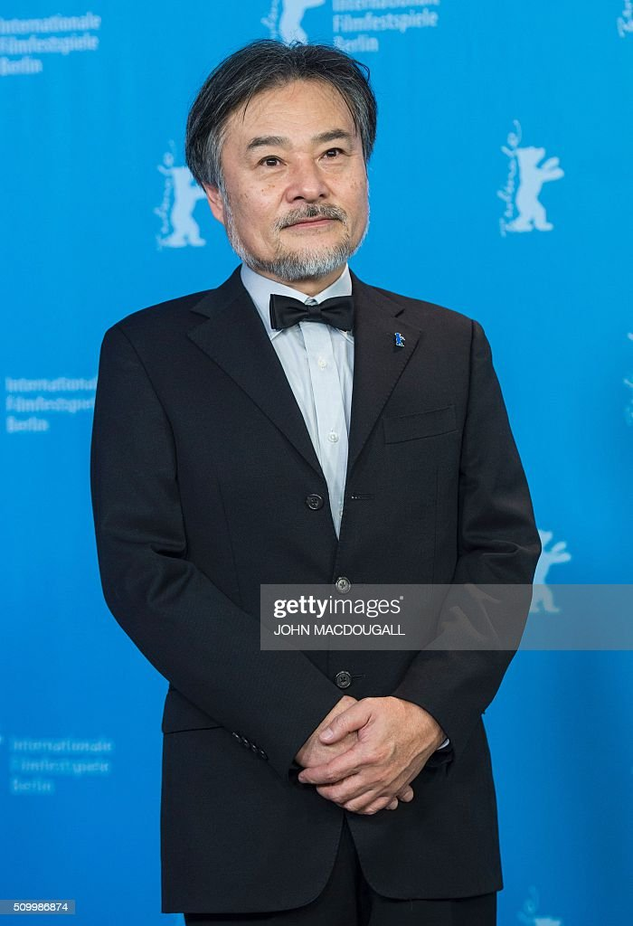 Japanese director Kiyoshi Kurosawa poses during a photocall for the film 'Creepy' at the 66th Berlinale Film Festival in Berlin on February 13, 2016. / AFP / John MACDOUGALL