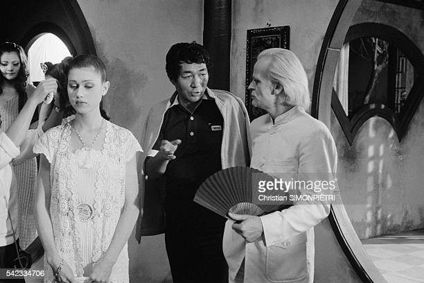 Japanese director Shuji Terayama and actors Isabelle Iliers and Klaus Kinski on the set of movie Fruits of Passion the followup to Histoire d'O