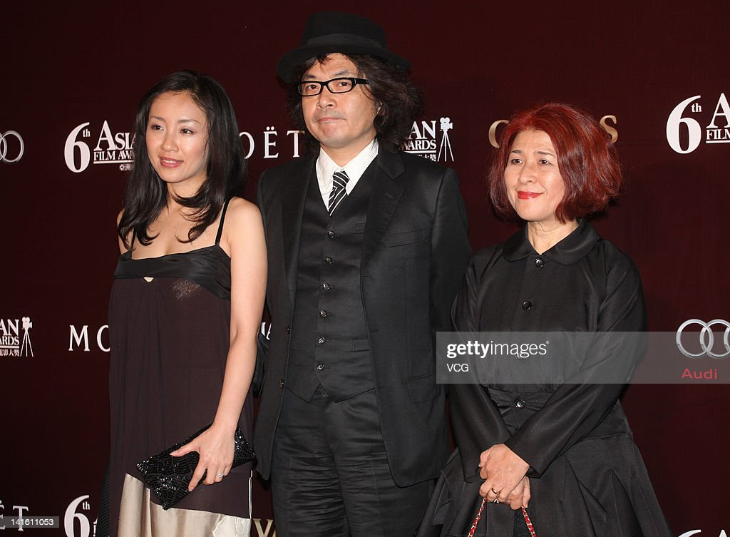 Japanese director <a gi-track='captionPersonalityLinkClicked' href=/galleries/search?phrase=Sion+Sono&family=editorial&specificpeople=6541524 ng-click='$event.stopPropagation()'>Sion Sono</a> (C) poses at the red carpet during the 6th Asian Film Awards at Hong Kong Convention and Exhibition Center on March 19, 2012 in Hong Kong, Hong Kong.