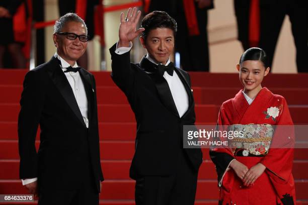 Japanese director Takashi Miike Japanese actor Takuya Kimura and Japanese actress Hanna Sugisaki pose on May 18 2017 as they arrive for the screening...