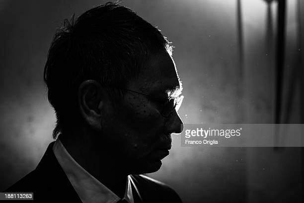 Japanese director Takashi Miike poses for the 'The Mole Song' Portrait Session during The 8th Rome Film Festival at Auditorium Parco Della Musica on...