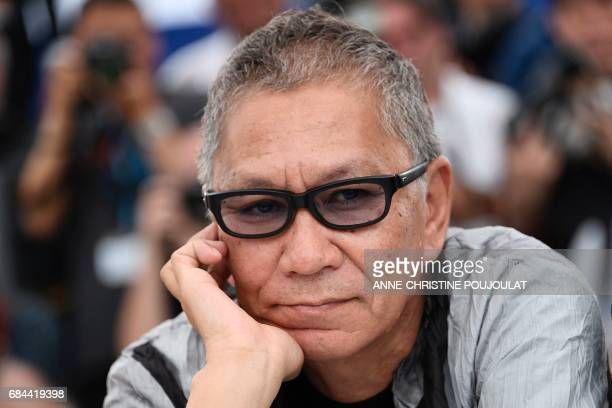 Japanese director Takashi Miike poses on May 18 2017 during photocall for the film 'Blade of the Immortal' at the 70th edition of the Cannes Film...