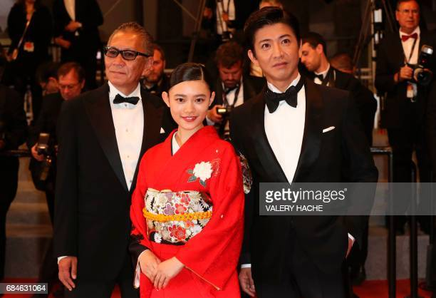 Japanese director Takashi Miike poses on May 18 2017 with Japanese actor Takuya Kimura and Japanese actress Hanna Sugisaki as they arrive for the...