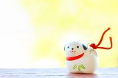 A cute Japanese dog ornament for celebrating new year on green background.