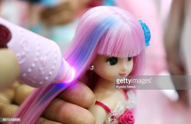 Japanese doll Liccachan whose hair color changes from pink to blue when lighted is displayed at Tomy Co's booth at the International Tokyo Toy Show...
