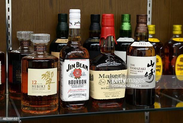 Japanese drink giant Suntory's whisky Yamazaki Hibiki and US beverage giant Beam's bourbon whisky Jim Beam Maker's Mark are displayed at Suntory's...