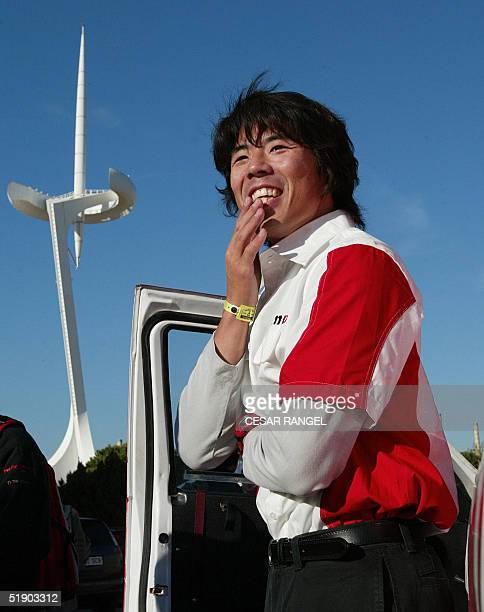 Japanese driver Jun Mitsuhashi smiles during the BarcelonaDakar preliminary tests in Barcelona 30 December 2004 on the eve of the start of the 27th...