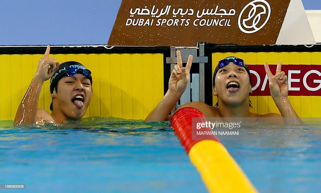 Japanese duo Kazuki Kohinata (L) and Kazuki Utsunomiya gesture after winning the gold and silver medals respectively in the men's 200m Breaststroke at the 9th Asian Swimming Championships in Dubai, on November 17, 2012.