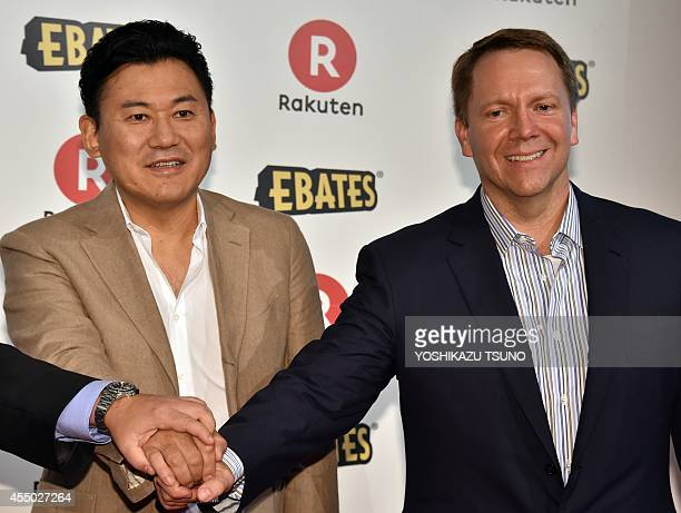 Japanese ecommerce giant Rakuten CEO Hiroshi Mikitani shakes hands with Kevin Johnson CEO of US online shopping operator Ebates as they annouince...