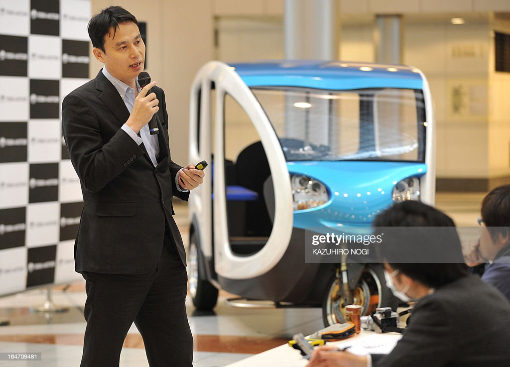Japanese electric vehicle manufacturer Terra Motors President Toru Tokushige (L) speaks during a press preview to announce the company's prototype model of an EV Tricycle Taxi in Tokyo on March 27, 2013. The taxi carries 6 passengers and the Japanese venture is confident in winning a big slice of the tuk-tuk market in Asia.