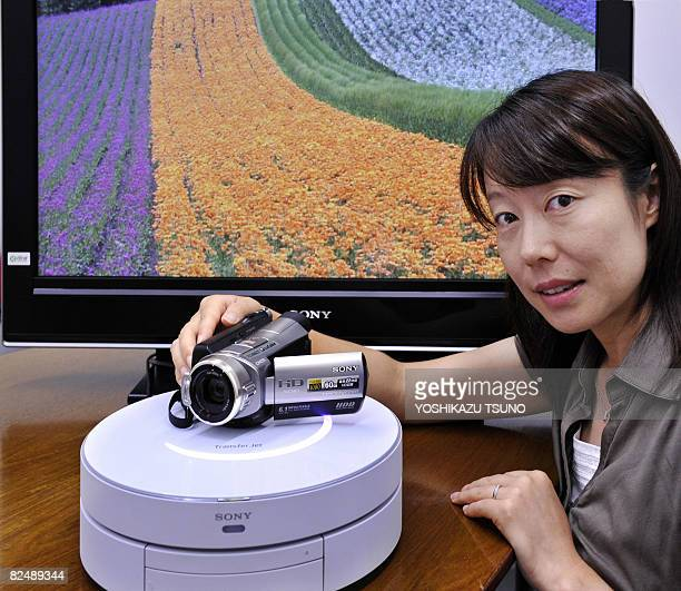 A Japanese electronics giant Sony employee demonstrates the new close proximity wireless transfer technology 'TransferJet' which can transmit a large...