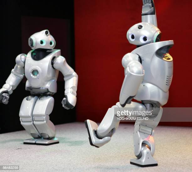 Japanese electronics giant Sony's humanoid robots Qrio display dance a Argentine tango for a Christmas special stage at Tokyo's Sony showroom 23...